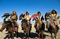 A group of eagle hunters from the Altai region arrive to the eagle hunting festival at Olgii in western Mongolia