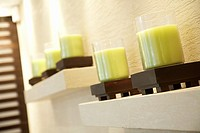 Close up of green candles on a shelf