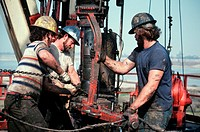 Men working on an oil drilling rig in Huntington Beach, California.