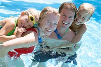 Family Hugging in Swimming Pool