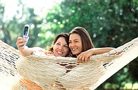 Women Taking Picture with Camera Phone