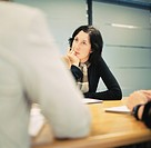Woman Listening in Business Meeting