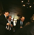 Businessmen Socializing in a Bar
