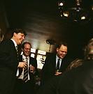 Businessmen Socializing in a Bar