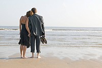 Smartly Dressed Couple on Beach