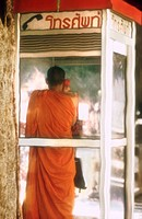Buddhist Monk in Phone Booth