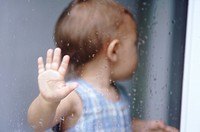 Baby turns away from window