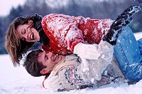 Playful couple laughing in the snow