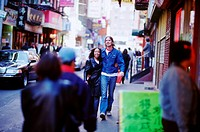 Young couple walking in Chinatown