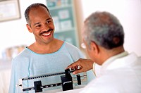 Weighing a cheerful patient