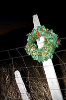 Christmas wreath on fence post in Wyoming