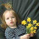 Girl holding daffodils