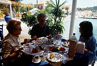 Posidhonio Samos Greece Family Chatting Over A Meal In Restaurant