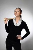 Businesswoman with baseball bat