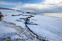 Rare occurance of Snow covered Chesil Beach and Boats at Burton Bradstock Dorset