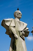 The memorial to Antonio Ferreira Gomes 1906 - 1989, the Bishop of Porto by Arlindo Rocha with pigeon on head