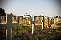 Unmarked cross headstones in graveyard