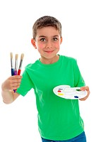 A beautiful smiling young boy holding artist paints and brushes. White background.