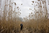 Man Standing in Tall Grass