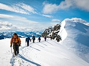 Roped mountaineering team descending the summit north ridge of Mount Chamberlin, Brooks Range, Arctic National Wildlife Refuge, Brooks Range, Summer i...