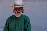 Smiling Man Wearing a Cowboy Hat