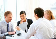 Photo of confident employees planning work in office