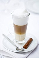 Latte macchiato and a chocolate bar