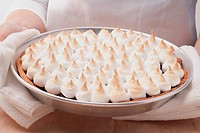 A fruit tart topped with meringue