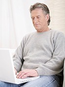 Germany, Hamburg, Senior man using laptop (thumbnail)