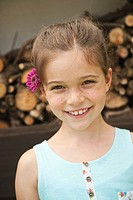 Germany, Bavaria, Girl with flowers, smiling, portrait