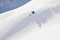 Austria, Zurs, Lech, Young man doing alpine skiing on Arlberg mountain