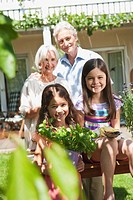 Germany, Bavaria, Family gardening together, smiling