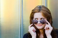 Happy young woman portrait with a sunglasses