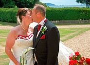 Bride and Groom Kissing with Roses
