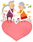 Portrait of elderly couple standing on heart shape (thumbnail)