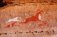 Painted hunting scene, rock art in the Akakus Mountains, Sahara Desert, Libya