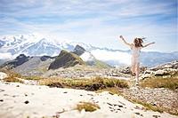 Girl walking in rocky landscape