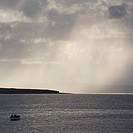 Fishermen escaping storm in small boat (thumbnail)