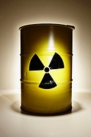 Studio shot of metal barrel with radiation warning sign