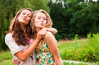 Teenage girls fooling around and puckering lips (thumbnail)