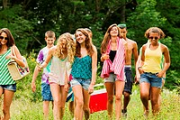 Teenagers going on a picnic together in the countryside