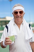 Older man drinking lemonade outdoors