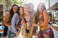 Portrait of group of smiling friends on vacations in resort
