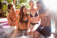 Group of friends relaxing in jacuzzi