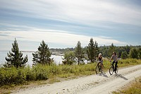 Couple bicycling on rural dirt path
