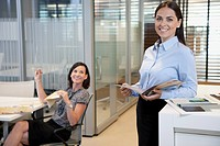 Happy businesswomen posing in office