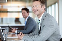 Portrait of businessmen working at desk in office