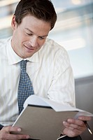 Portrait of businessman reading document