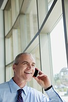 Portrait of mature businessman talking on cell phone