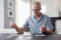 Man playing solitaire at home